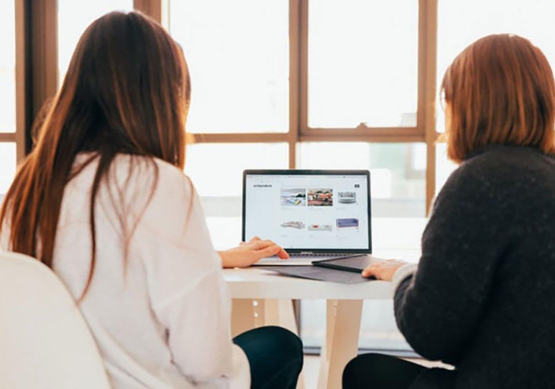 Women analyzing on computer