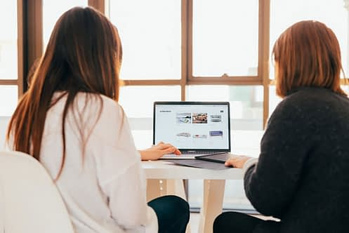 Women analyzing on computer