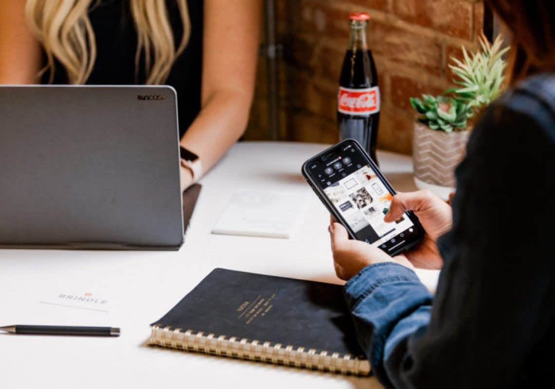 social media marketing team using phone